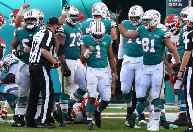 Miami Dolphins quarterback Tua Tagovailoa (1) celebrates a touchdown in the fourth quarter against the Kansas City Chiefs at Hard Rock Stadium in Miami Gardens, December 13, 2020.