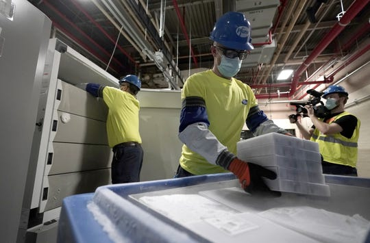 Boxes containing the Pfizer-BioNTech COVID-19 vaccine are prepared to be shipped at the Pfizer Global Supply Kalamazoo manufacturing plant in Portage, Mich.