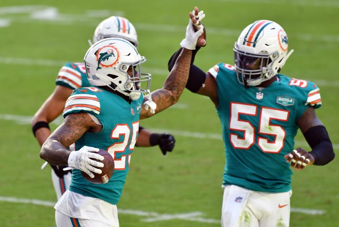 Miami Dolphins cornerback Xavien Howard (25) celebrates an interception in the end zone with teammate Jerome Baker (55) against the Kansas City Chiefs at Hard Rock Stadium in Miami Gardens, December 13, 2020.