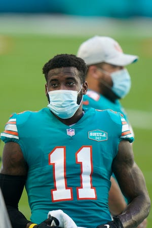 Dolphins receiver DeVante Parker was forced to leave the Chiefs game without a reception.
