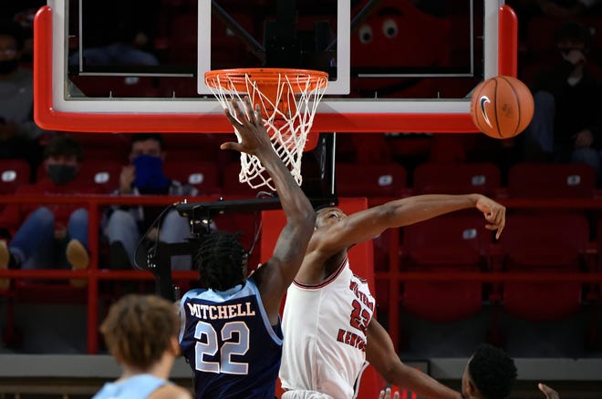 The Hilltoppers' Charles Bassey swats away a shot by the Rams' Makhel Mitchell during Sunday's game in Kentucky.
