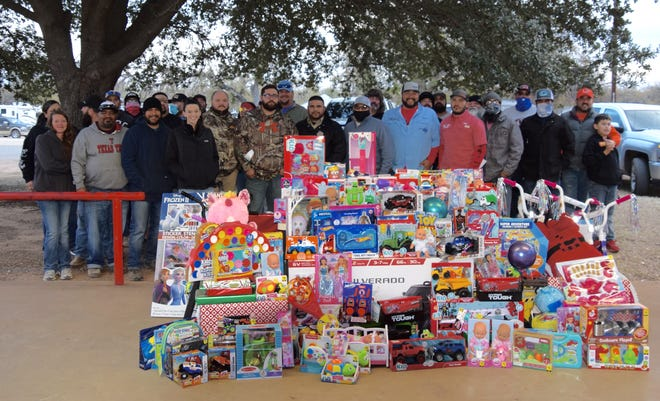 The contestants were in the Christmas spirit as they donated toys for the Coal Burnin' Toy Drive BBQ Cook-off. Several bicycles as well as dozens of other toys were donated to the Runnels County Sheriff's Department annual toy drive.