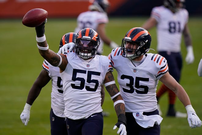 Chicago Bears' Josh Woods (55) celebrates a fumble recovery during the second half of an NFL football game against the Houston Texans, Sunday, Dec. 13, 2020, in Chicago. (AP Photo/Nam Y. Huh)