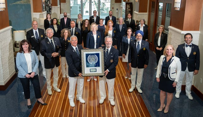 Sarasota Yacht Club board members, leaders and staff gather to celebrate being selected as a Platinum Club of America.