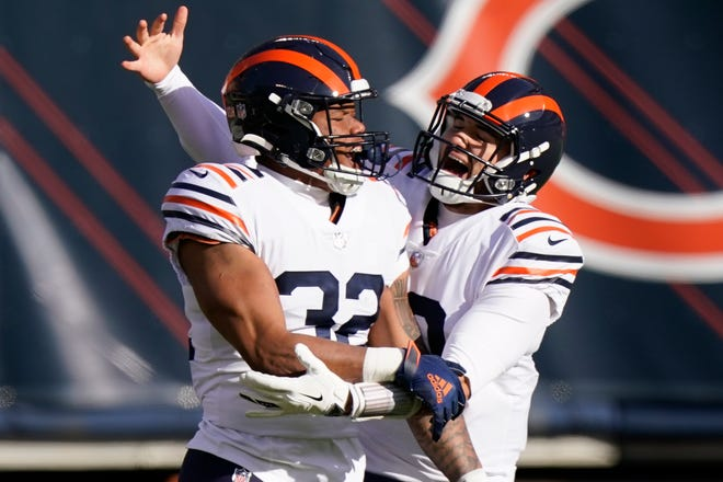 Chicago Bears running back David Montgomery (32) celebrates a touchdown run with quarterback Mitchell Trubisky (10) during the first half of an NFL football game against the Houston Texans, Sunday in Chicago. [NAM Y. HUH/THE ASSOCIATED PRESS]