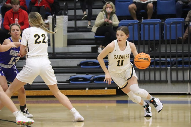 Tecumseh's Kenzli Warden (11) prepares to dribble around a screen set by teammates Baylee Crawford (22) Saturday during the girls' championship game of the First United Bank Classic at Bethel High School's B.E. Cantrell Fieldhouse.