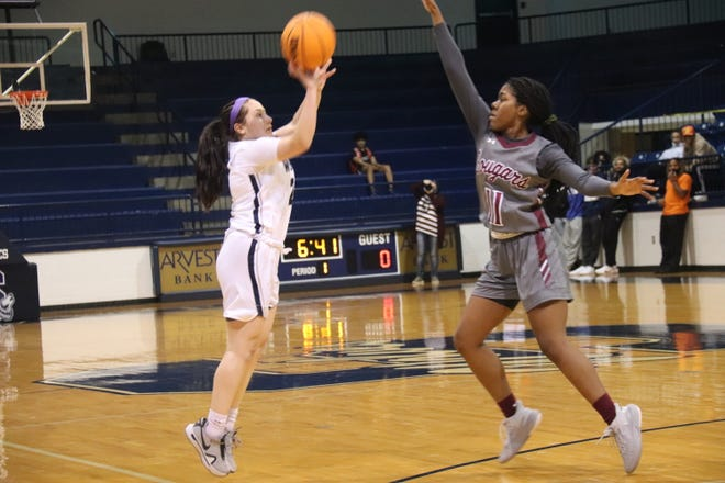 Shawnee's Kaitlyn Taylor (left) puts up a shot against Ada earlier this season.
