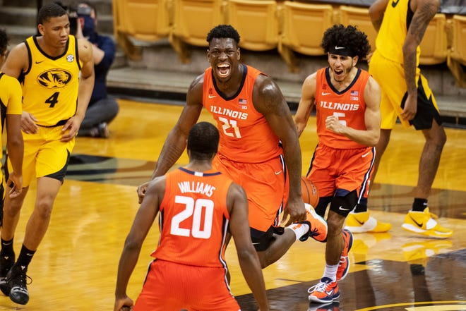 Illinois' Kofi Cockburn, ctop enter, celebrates his dunk with teammates Andre Curbelo, right, and Da'Monte Williams (20) as Missouri's Javon Pickett, left, looks on during the second half of an NCAA college basketball game Saturday, Dec. 12, 2020, in Columbia, Mo. (AP Photo/L.G. Patterson)