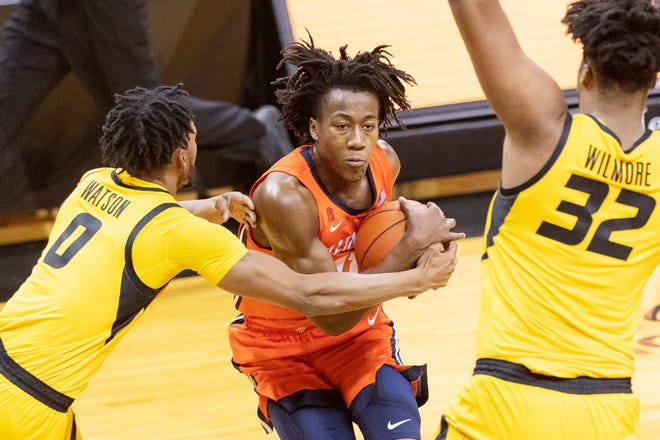 Illinois' Ayo Dosunmu, right, is fouled by Missouri's Torrence Watson, left, Saturday, Dec. 12, 2020, in Columbia, Mo.