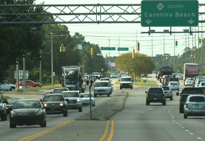 Traffic travels onto College Road from Shipyard Blvd Friday Oct. 9, 2020.