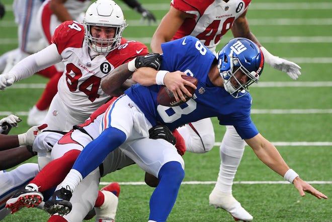 Giants quarterback Daniel Jones is sacked by Arizona Cardinals linebacker Haason Reddick (behind Jones) during the second half on Sunday.