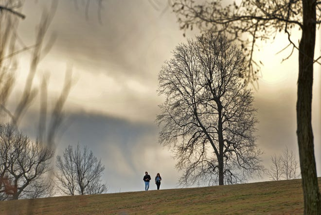 WORCESTER - A couple walks along the ridge of a hill in Green Hill Park on Sunday. With temperatures climbing into the 50s, it was a pleasant day for a stroll. Later this week, however, colder temps and heavy snow are expected in the region.