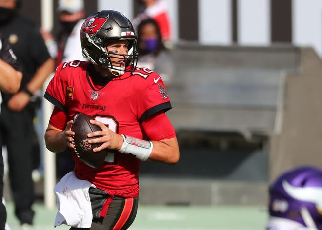 Buccaneers quarterback Tom Brady drops back against the Vikings during the second quarter.
