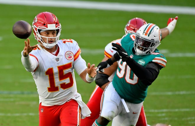 Chiefs quarterback Patrick Mahomes (15) releases a pass against the Dolphins during Sunday's first half.