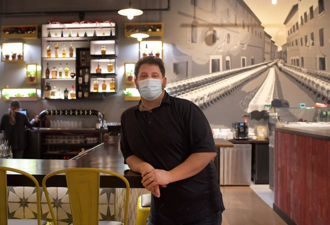 Peter Rano, owner of 'Olo Pizza,  poses inside the establishment in Worcester.