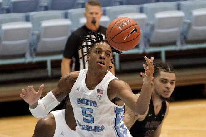 UNC forward Armando Bacot (5) finished with 19 points and 11 rebounds in the Tar Heels' 73-67 win against N.C. Central on Saturday. (AP Photo/Gerry Broome)