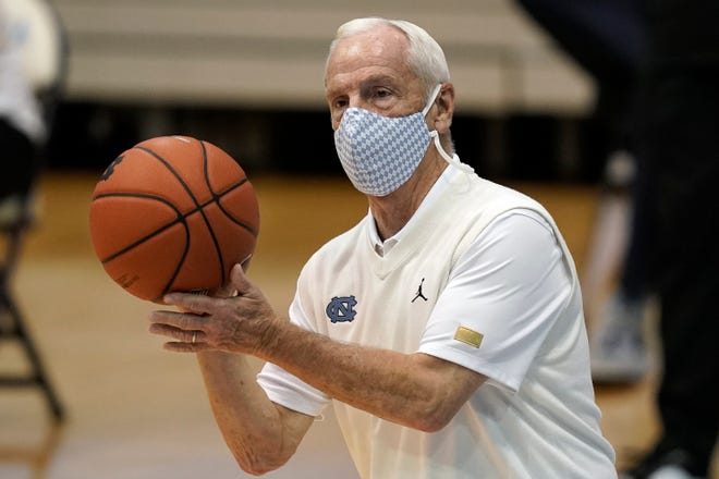 """When asked to address Duke coach Mike Krzyzewski's comments on playing college basketball amid the COVID-19 pandemic, UNC coach Roy Williams said he has """"a tremendous amount of faith"""" in Krzyzewki."""