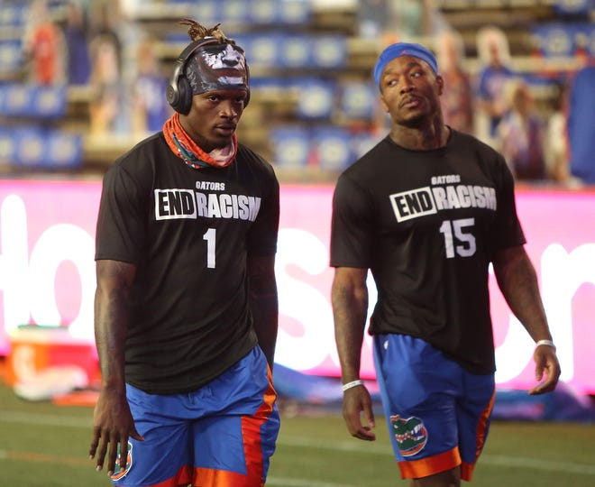 Florida Gators receivers Kadarius Toney (1) and Jacob Copeland (15)  during warmups before the football game against the LSU Tigers at Ben Hill Griffin Stadium in Gainesville, Fla. Dec. 12, 2020.