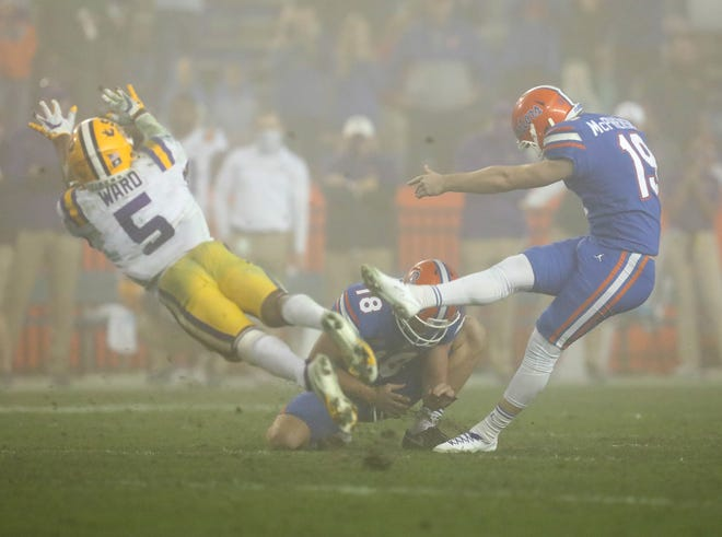 Florida kicker Evan McPherson boots a last-second field goal attempt Saturday against LSU at Ben Hill Griffin Stadium. The 51-yard try was wide left in Florida's 37-34 loss.