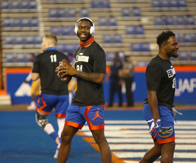 Florida tight end Kyle Pitts (84) jokes with teammates during warm-ups before Saturday's game against LSU at Ben Hill Griffin Stadium. Pitts was a late scratch from the game due to a previous injury.