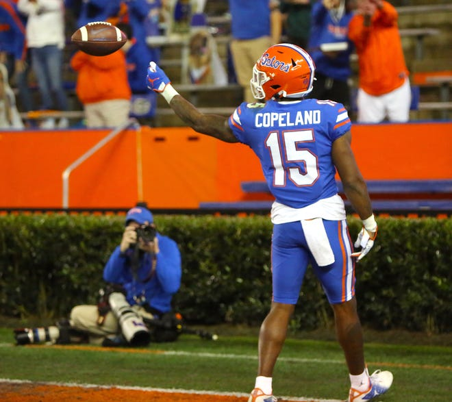 Florida Gators receiver Jacob Copeland (15) flips the ball to a referee after catching a touchdown pass during a game against the LSU Tigers at Ben Hill Griffin Stadium in Gainesville, Fla. Dec. 12, 2020.   [Brad McClenny/The Gainesville Sun]