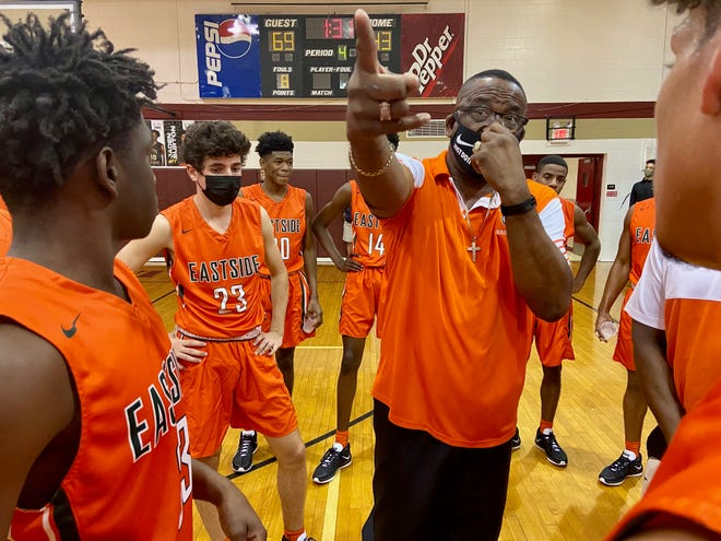 """Herman """"Pop"""" Williams directs his Eastside High players during Saturday evening's game at the Tim Brinkley Memorial at North Marion High School."""