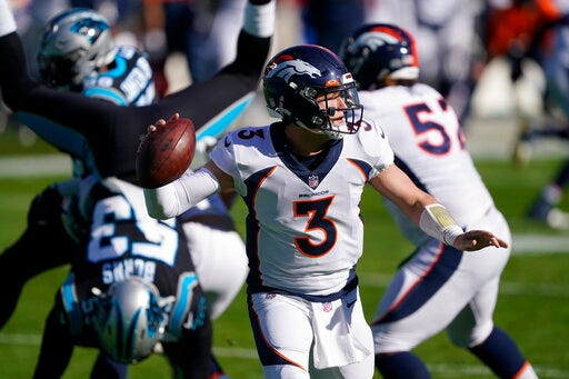 Denver Broncos quarterback Drew Lock passes against the Carolina Panthers during the first half on Sunday in Charlotte, N.C. (AP Photo/Brian Blanco)