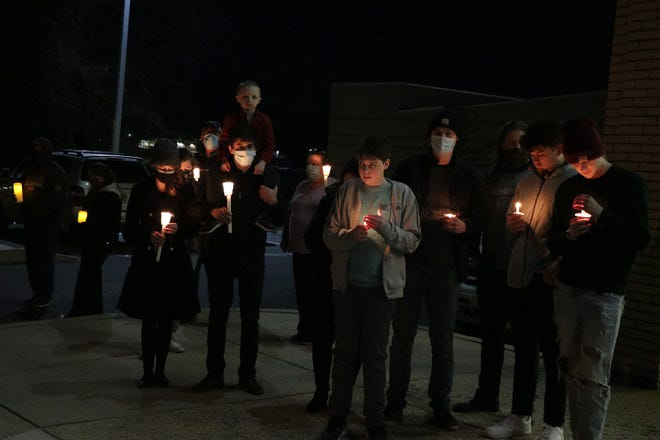 Between 75 and 100 people attended a candlelight vigil at Waynesboro Area Senior High School Saturday evening in memory of Charles Thomas, the beloved substitute teacher who died Dec. 7 at the age of 85. Several people offered remarks and 'Sweet Violets,' the song he sang every day, was played.