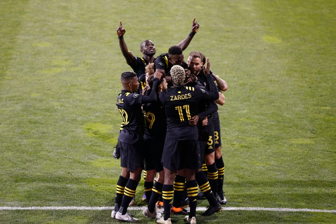 Columbus Crew players celebrate a goal against the Seattle Sounders during the first half of the MLS Championship soccer match Saturday, Dec. 12, 2020, in Columbus, Ohio. (AP Photo/Jay LaPrete)