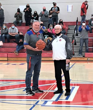 Zane Trace boys basketball coach Gary Kellough picked up his 500th career coaching win Saturday night when the Pioneers defeated Huntington, 65-41, and he was presented with the game by Zane Trace athletic director Andrew Merriman after the win. Kellough, who the 2008 Division II state championship at Chillicothe High School, has led Zane Trace to back-to-back district championships. Kellough's coaching record now stands at 500-272. Look for a more in-depth story on Kellough's career this week in the Gazette.