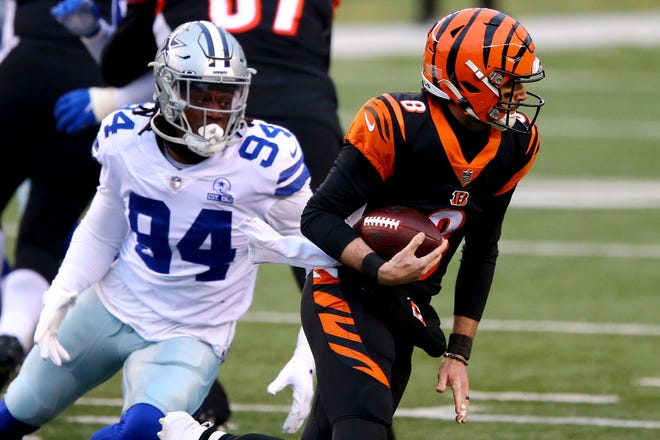 Dallas Cowboys defensive end Randy Gregory, left, harasses Cincinnati Bengals quarterback Brandon Allen during the team's match up on Sunday. Gregory has contributed 12 tackles, two sacks and 12 quarterback pressures in limited playing time since returning from a league suspension.