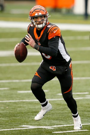 Cincinnati Bengals quarterback Brandon Allen (8) scrambles out of the pocket in the first quarter of the NFL Week 14 game between the Cincinnati Bengals and the Dallas Cowboys at Paul Brown Stadium in downtown Cincinnati on   Sunday, Dec. 13, 2020. The Cowboys led 17-7 at half time.