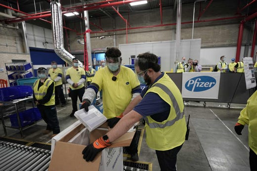 Boxes containing the Pfizer-BioNTech Covid-19 vaccine are prepared to be shipped at the Pfizer Global Supply Kalamazoo manufacturing plant in Kalamazoo, Mich. on Dece. 13, 2020.