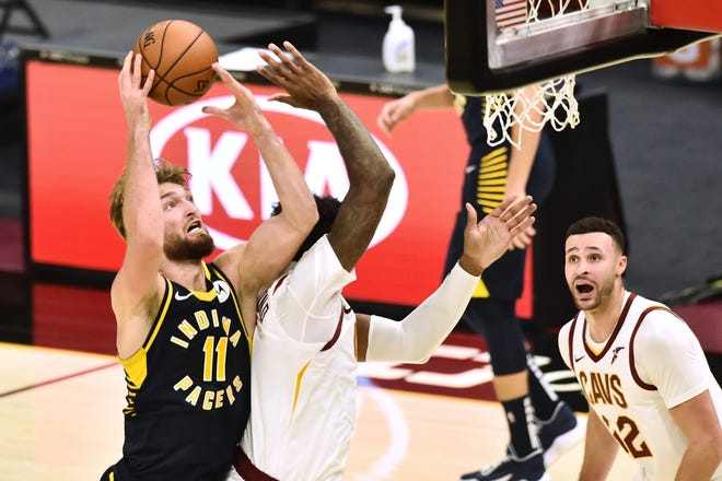 Dec 12, 2020; Cleveland, Ohio, USA; Indiana Pacers forward Domantas Sabonis (11) drives to the basket against Cleveland Cavaliers center Andre Drummond (3) during the second quarter at Rocket Mortgage FieldHouse. Mandatory Credit: Ken Blaze-USA TODAY Sports