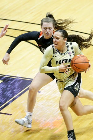Purdue guard Kayana Traylor (23) dribbles to the net against Bowling Green guard Kenzie Lewis (24) during the fourth quarter of an NCAA women's basketball game, Sunday, Dec. 13, 2020 at Mackey Arena in West Lafayette.