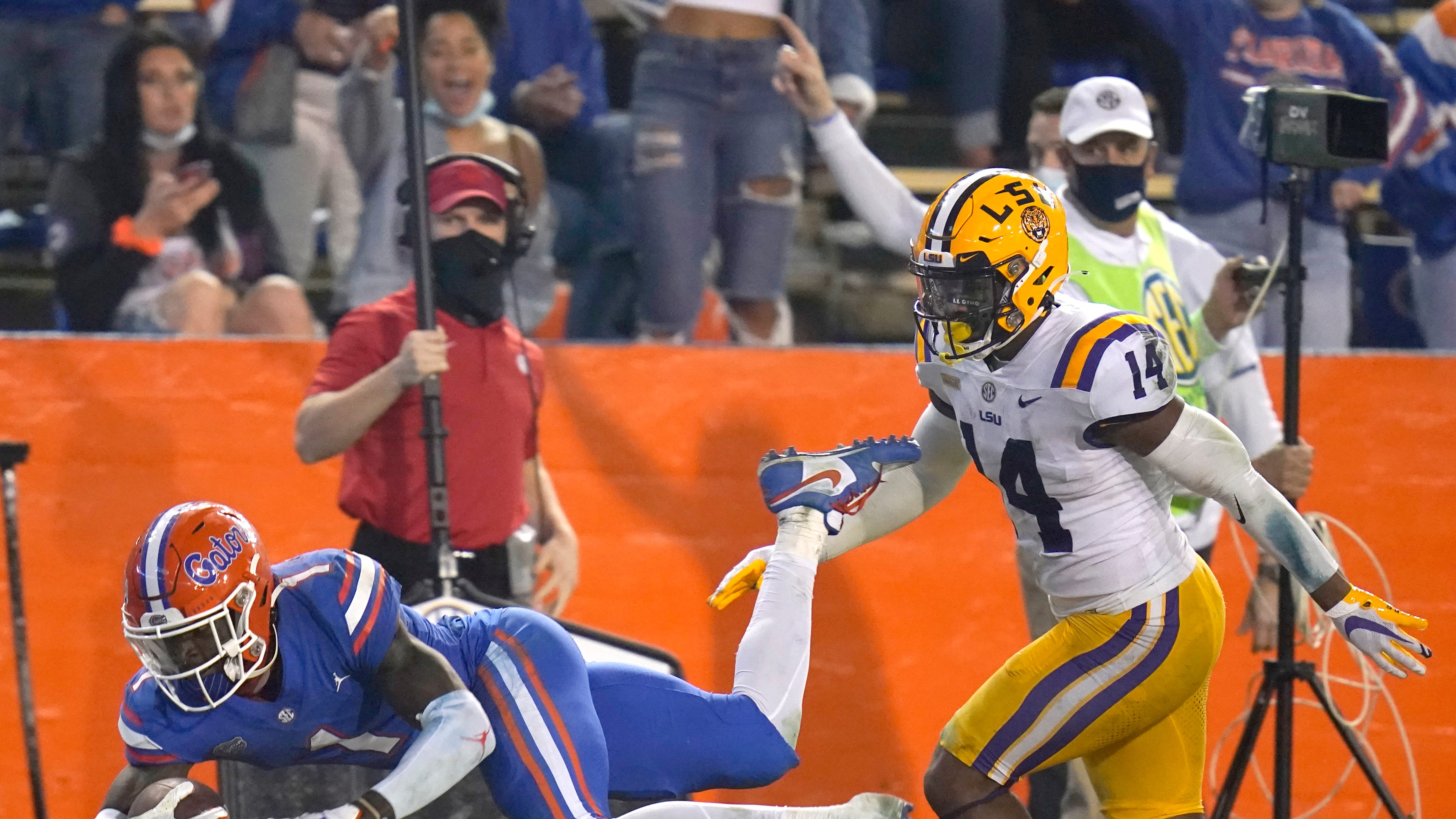 Florida wide receiver Kadarius Toney (1) is pushed out of bounds by LSU safety Maurice Hampton Jr. (14) after Toney caught a pass for a 49-yard gain during the second half of an NCAA college football game Saturday, Dec. 12, 2020, in Gainesville, Fla.