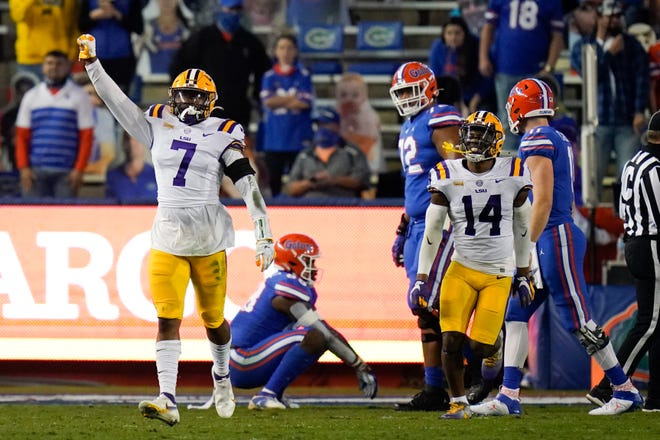 LSU safety JaCoby Stevens (7) and safety Maurice Hampton Jr. (14) celebrate after LSU stopped Florida on a fourth-and-goal at the 1-yard line during the first half of an NCAA college football game Saturday, Dec. 12, 2020, in Gainesville, Fla.