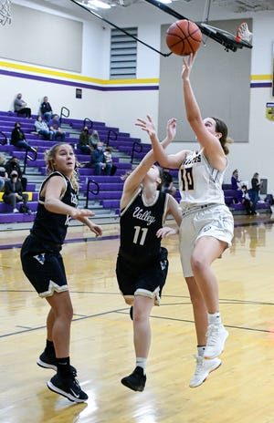 Bloom Carroll senior Carley Bryant attempts a lay up Saturday afternoon at BCHS. The visiting Vikings prevailed 32-15.