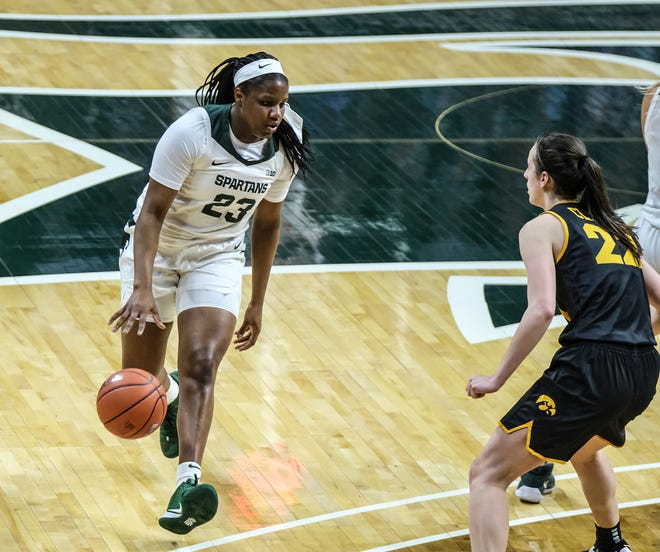 MSU's Janai Crooms (23) works the ball in against Iowa at the Breslin Center Saturday, Dec. 12, 2020. MSU held on to win 86-82.