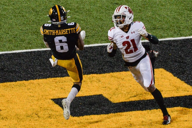Iowa wide receiver Ihmir Smith-Marsette catches a pass for a 53-yard touchdown as Wisconsin cornerback Caesar Williams pursues the play Saturday.