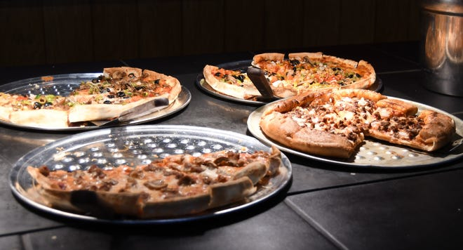 Four pizzas sit out on the buffet at the Mountain Home Pizza Inn on Saturday during a training day for staff and servers. The Mountain Home Pizza Inn officially reopened Tuesday after closing this summer.