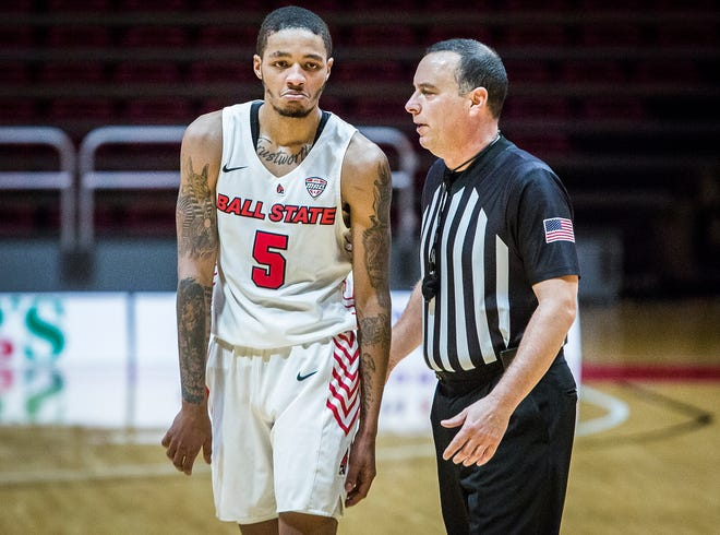 FILE -- Ball State's Ishmael El-Amin speaks with an official during BSU's game against Illinois State at Worthen Arena Saturday, Dec. 12, 2020.
