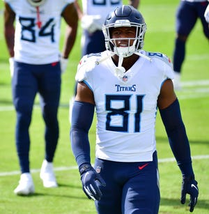 Jonnu Smith looks on before a game between the Titans and Jaguars at TIAA Bank Field on Dec. 13, 2020 in Jacksonville, Florida. The Patriots reportedly have agreed to sign Smith when free agency begins on Wednesday.