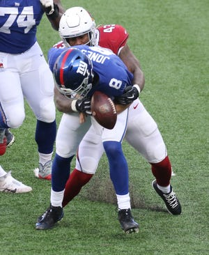Haason Reddick of the Cardinals strips Daniel Jones quarterback of the Giants of the ball but Jones recovered for a loss in the first half as the Arizona Cardinals played the New York Giants at MetLife Stadium in East Rutherford, NJ on December 13, 2020.