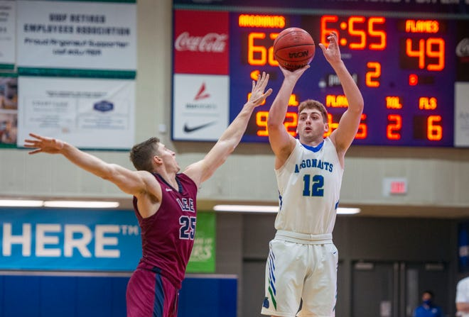West Florida's Tate Mulkey (12) goes up for two in second half action against the Lee Flames Saturday, December 12, 2020 at the UWF Field House.