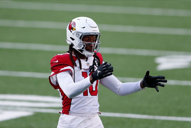 Arizona Cardinals wide receiver DeAndre Hopkins talks with referees during the first half of an NFL football game against the New York Giants, Sunday, Dec. 13, 2020, in East Rutherford, N.J. (AP Photo/Noah K. Murray)