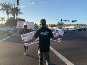 Nearly 30 people gathered near 48th Street and Ray Road to decry the death of 40-year-old Ryan Whitaker.