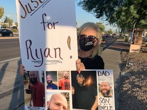 Diane Whitaker protests for her son Ryan, who was  shot by police in Ahwatukee Foothills in May.