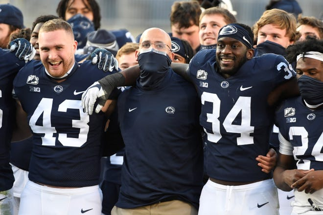 Penn State head coach James Franklin joins his players for the alma mater following an NCAA college football game against Michigan State in State College, Pa., on Saturday, Dec. 12, 2020. (AP Photo/Barry Reeger)