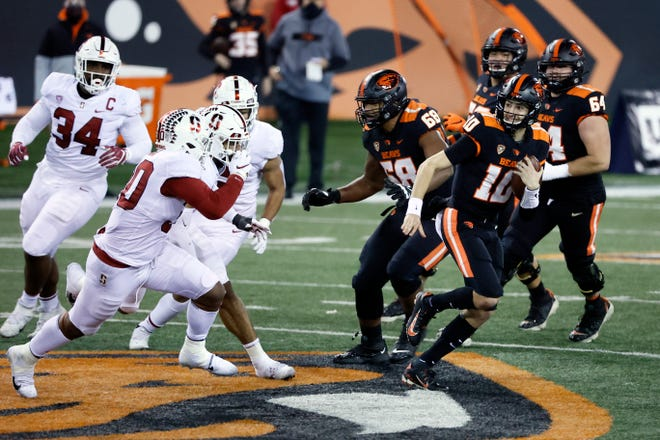 Dec 12, 2020; Corvallis, Oregon, USA; Oregon State Beavers quarterback Chance Nolan (10) runs with the ball on a keeper against the Stanford Cardinal during the first half at Reser Stadium. Mandatory Credit: Soobum Im-USA TODAY Sports